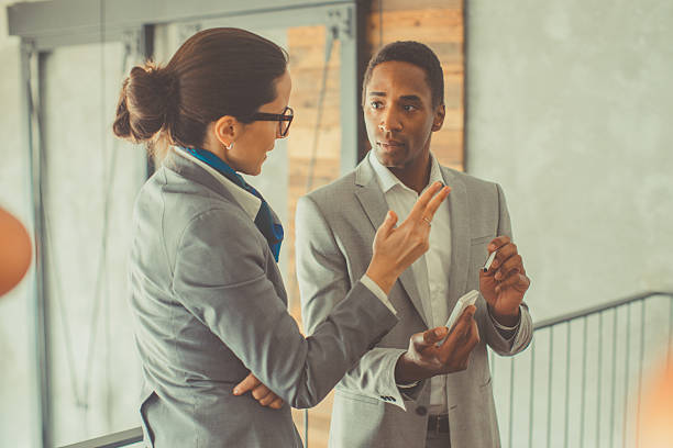 two colleagues having conversation stock photo
