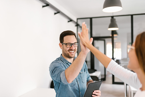 istock Two colleagues high-five. 1020064642