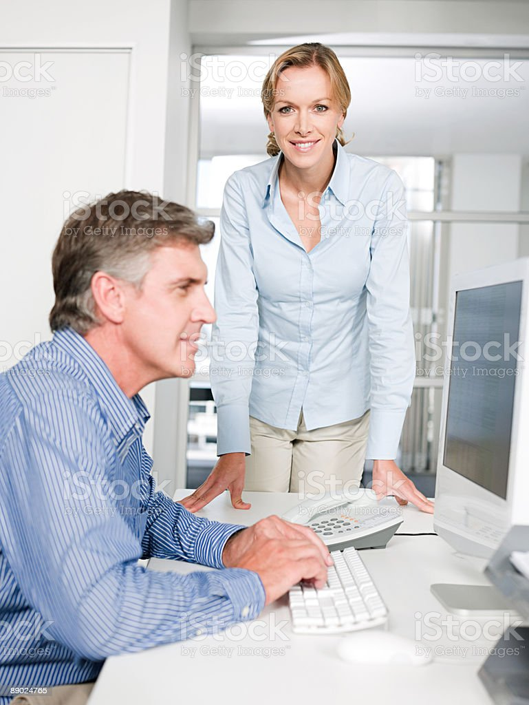 Two colleagues in an office royalty-free stock photo