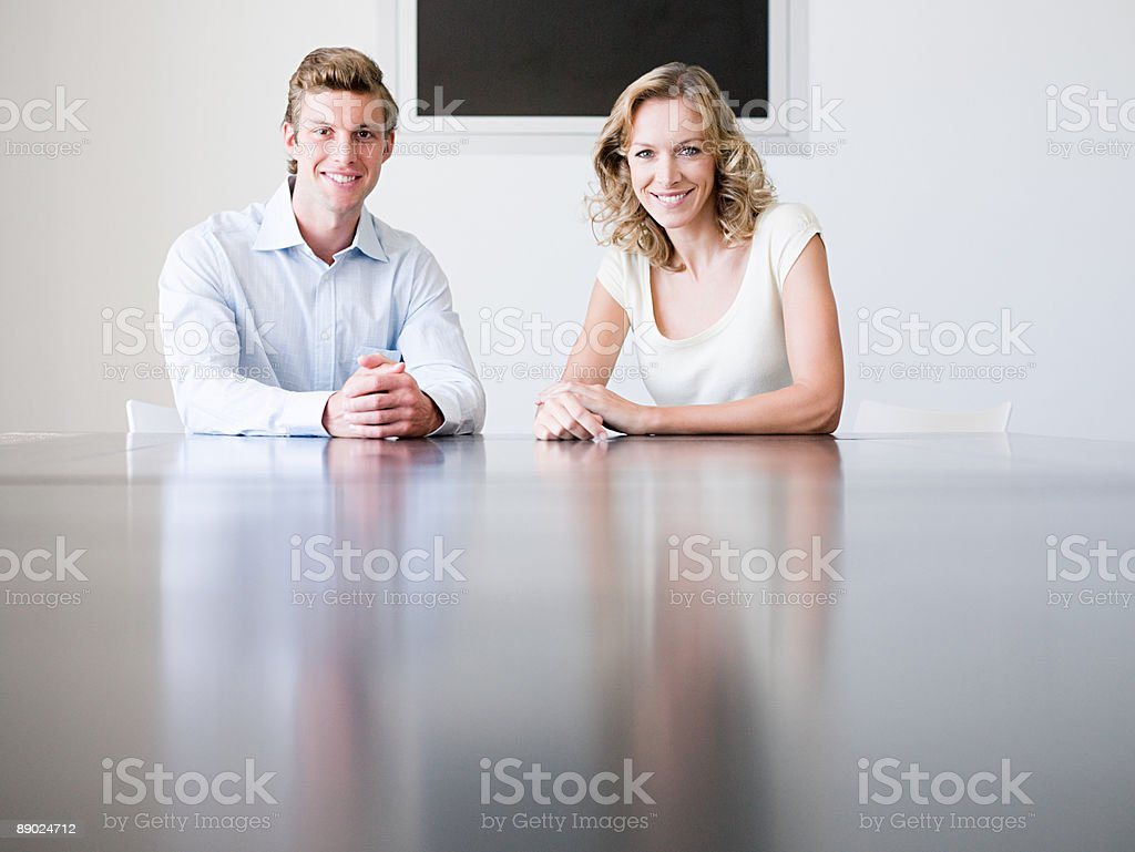Two colleagues sitting at a desk royalty-free stock photo