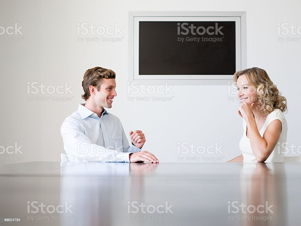 Two colleagues talking and smiling royalty-free stock photo