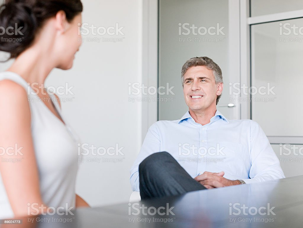 Two colleagues talking royalty-free stock photo