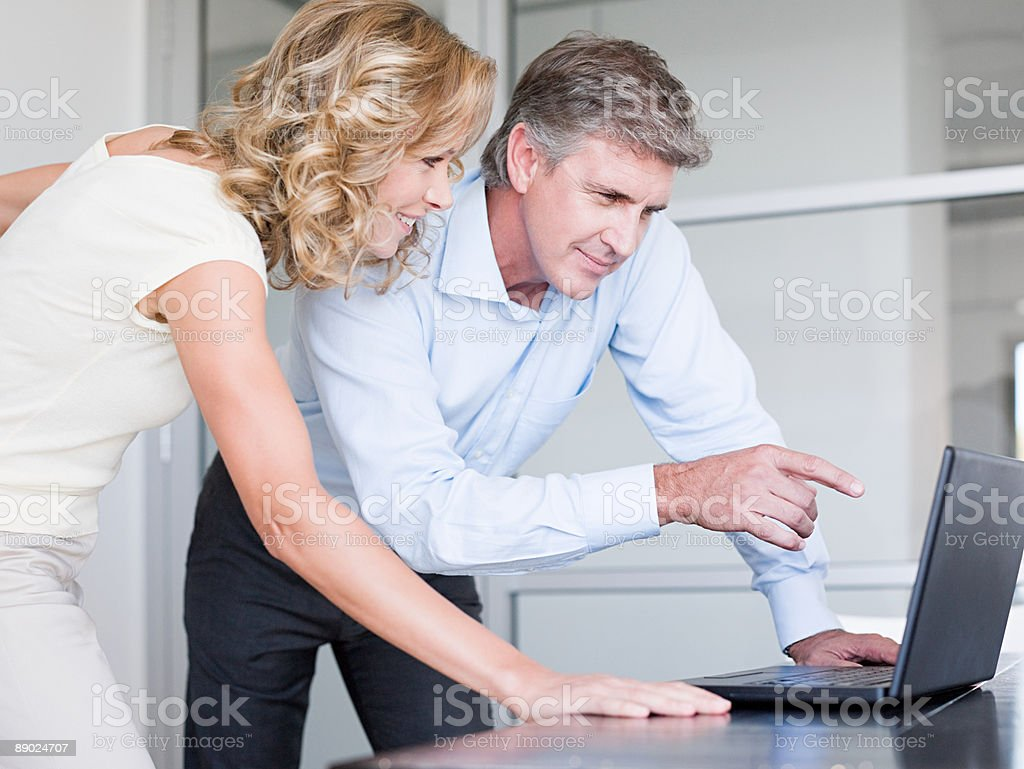 Two colleagues using a laptop computer royalty-free stock photo
