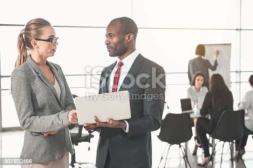 istock Two colleagues using modern technology 937920466