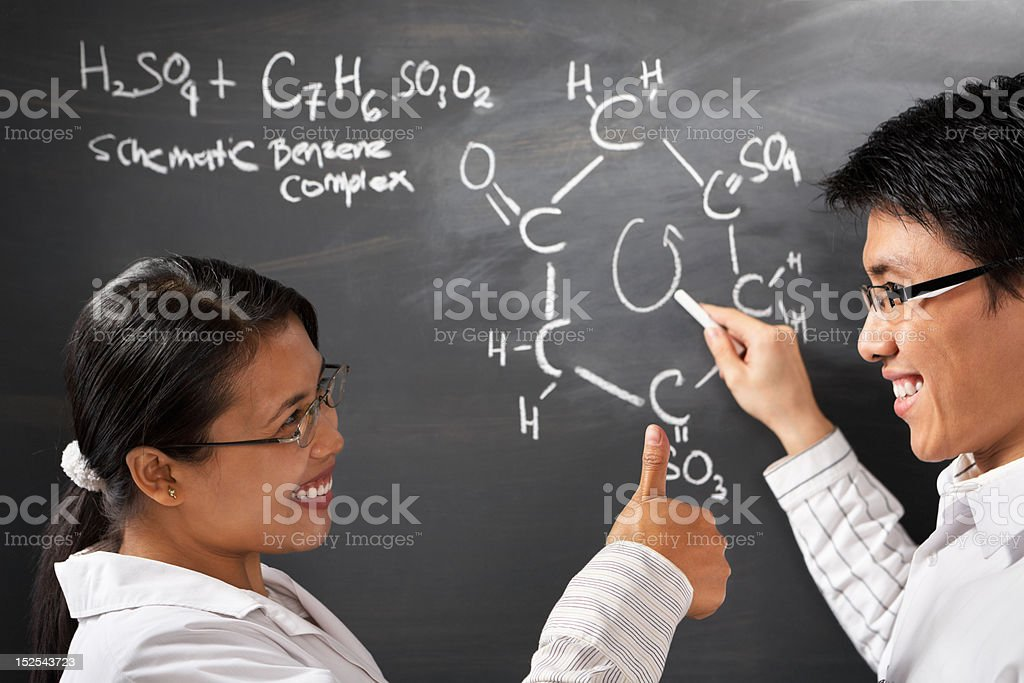 Two college student solving chmestry problem royalty-free stock photo