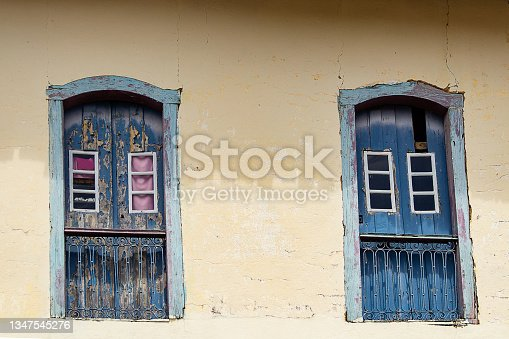 istock Two colonial-style windows. 1347545276