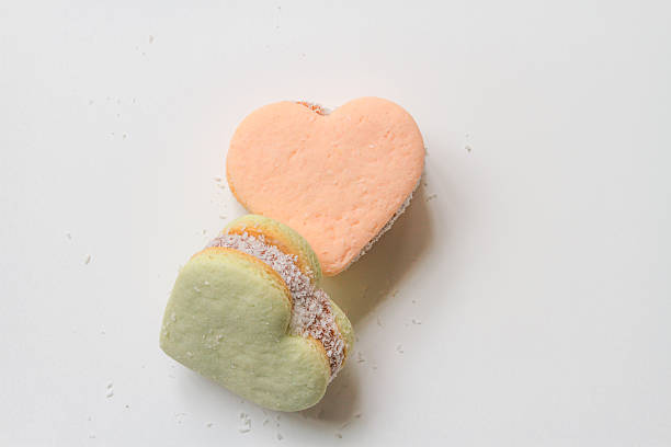 Two color alfajores cornstarch with heart shape on white backgro - foto de stock