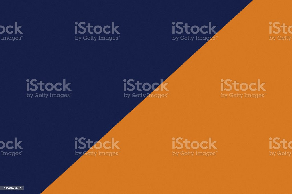 Two color paper with dark blue and orange of the image. Background royalty-free stock photo
