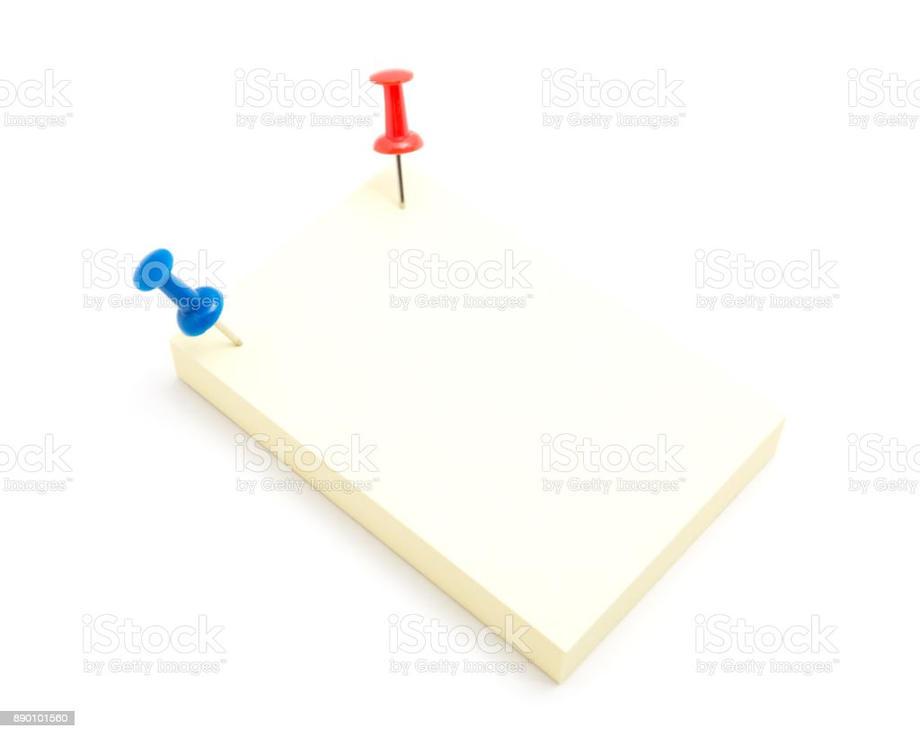 Two color push pins and yellow sticky note on isolated white background stock photo