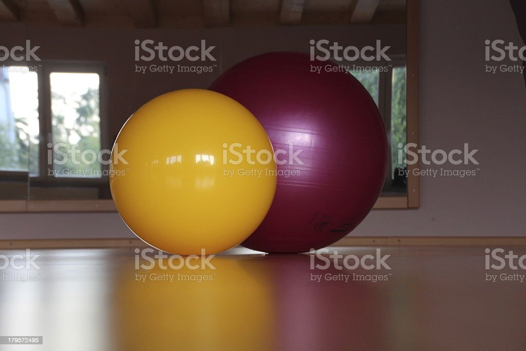Two colored fitness balls at the gym stock photo