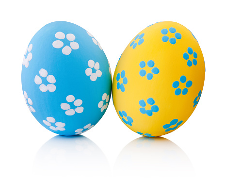 Two colorful handmade Easter eggs isolated on a white background
