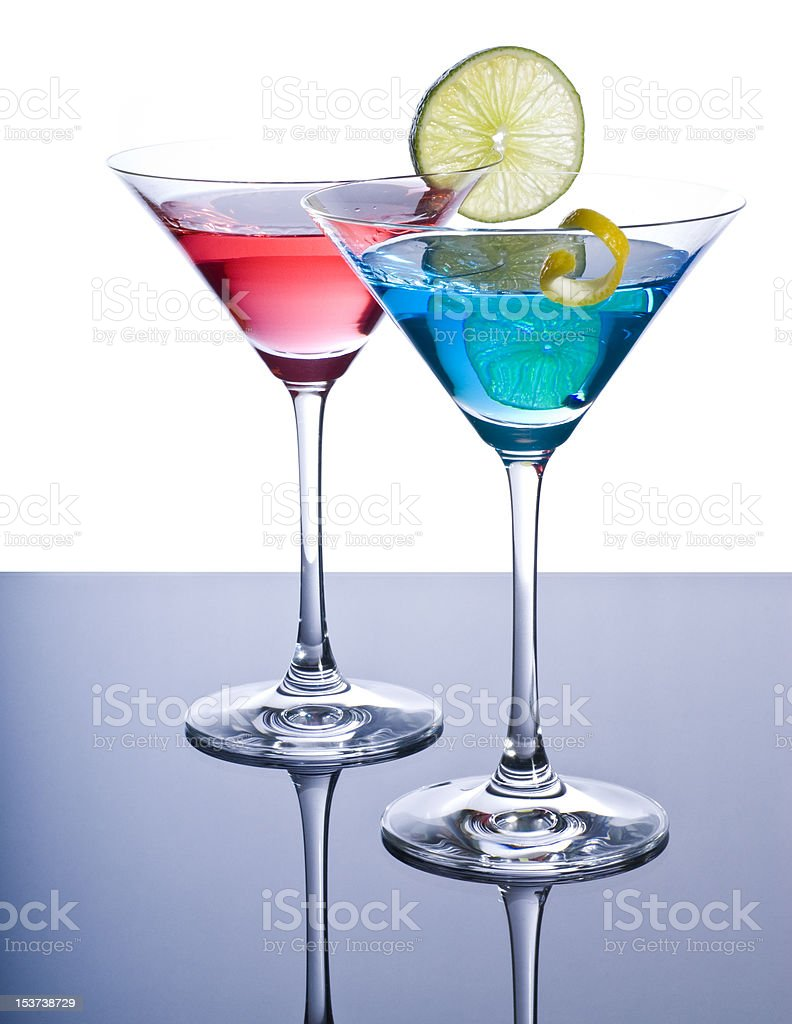 Two Colorful Martini's with Citrus Fruit stock photo