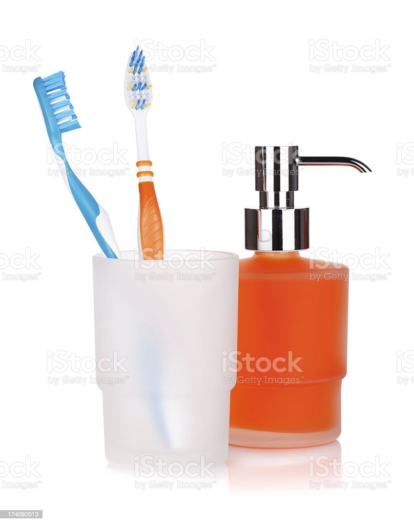 Two colorful toothbrushes and liquid soap royalty-free stock photo