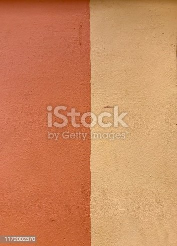 Detail of two colours on a wall vertical pattern and texture