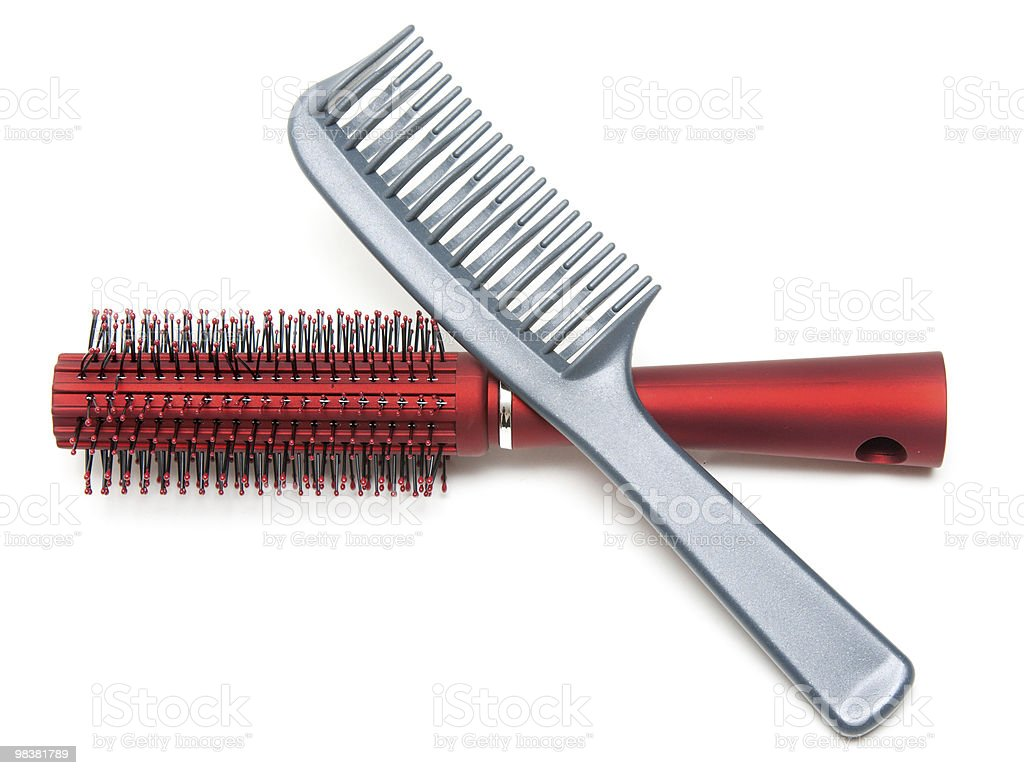 Two combs, red and sulfuric royalty-free stock photo