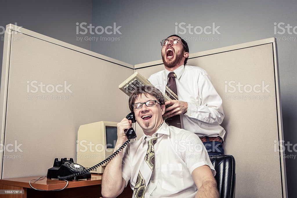 Two Comical Nerdy Office Workers, on Phone and Laughing stock photo