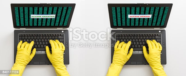 istock Two computer criminals hacking laptops top view 840177124