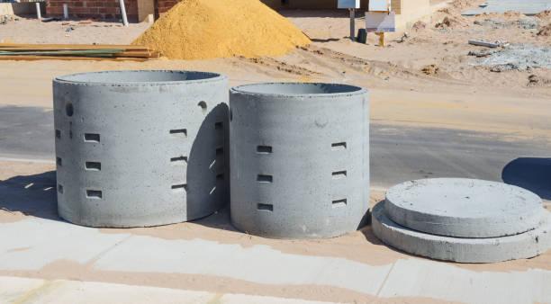 Two concrete soakwells stock photo