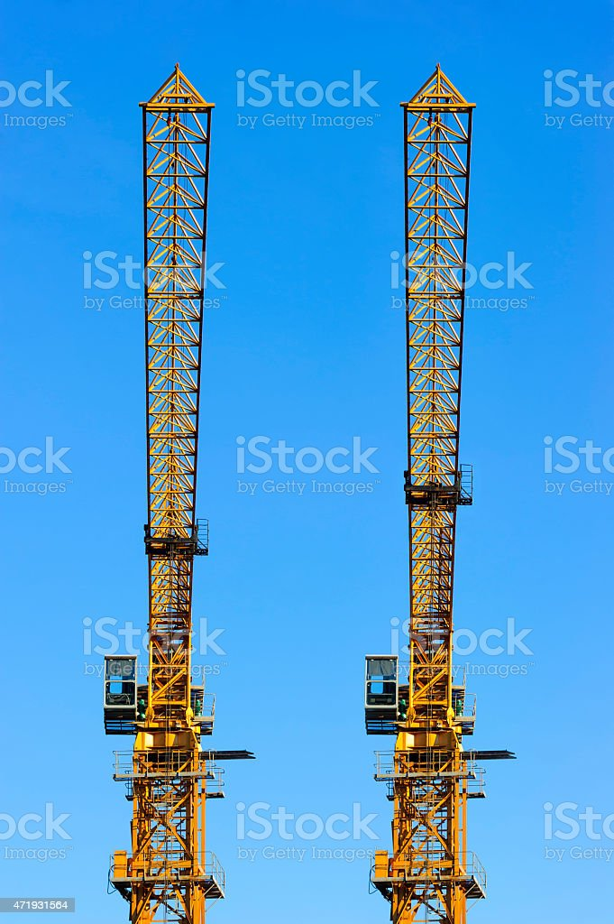 Two construction cranes stock photo