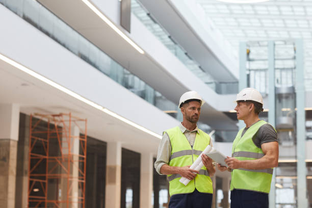 Two Construction Workers on Site stock photo