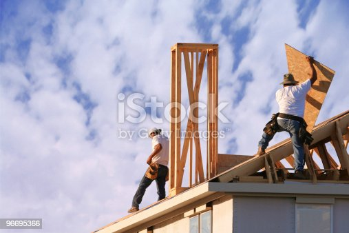 istock Two construction workers roof a new home 96695366