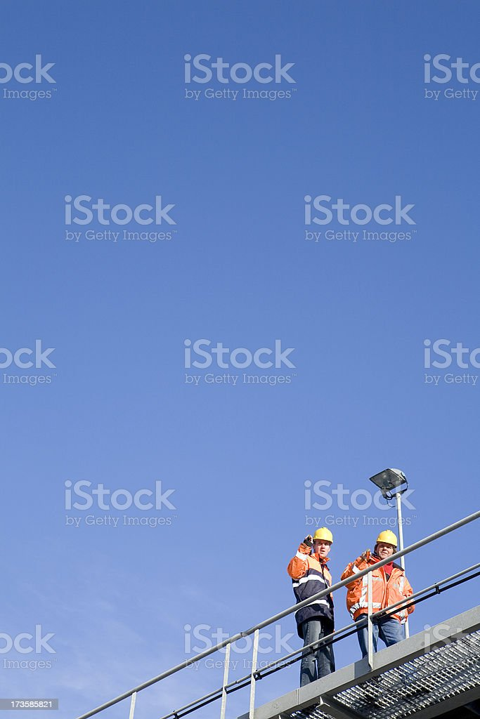 Two constructionworkers on a bridge royalty-free stock photo