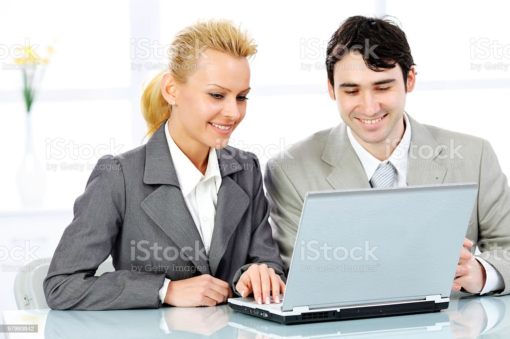 Two contemporary business persons working on laptop. royalty free stockfoto