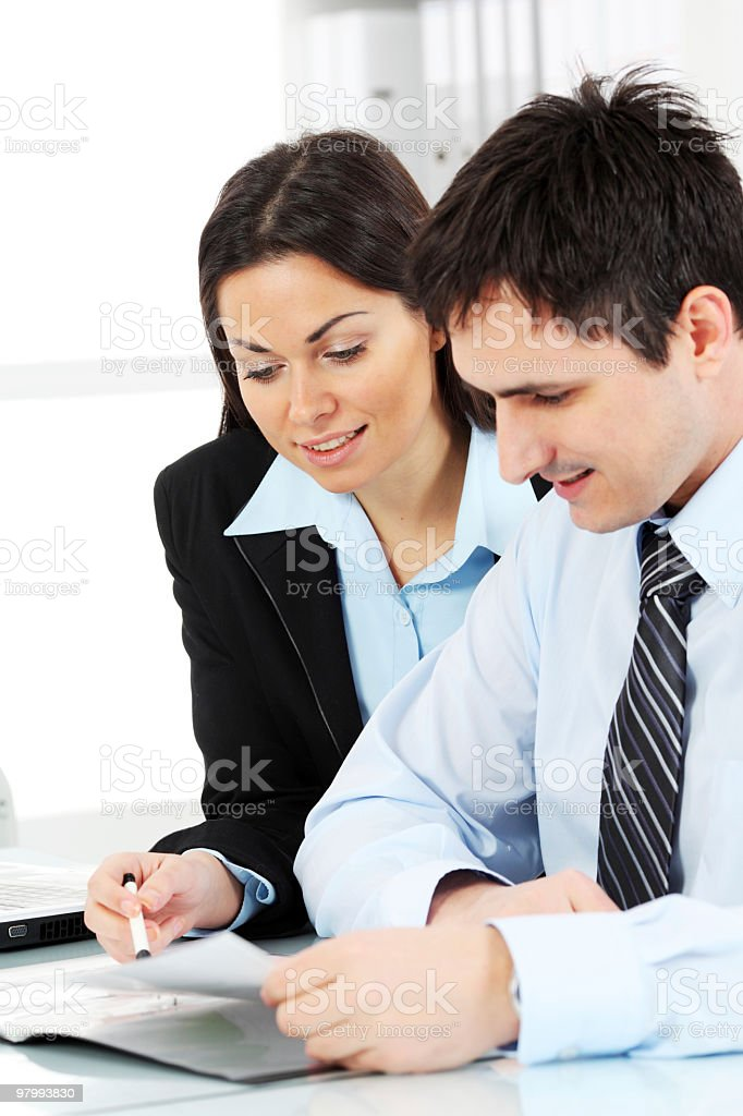 Two contemporary business persons working with documents. royalty-free stock photo