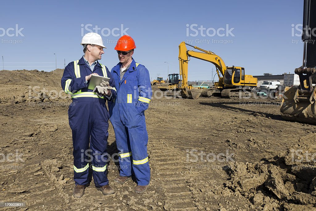 Two Contractors and PC royalty-free stock photo