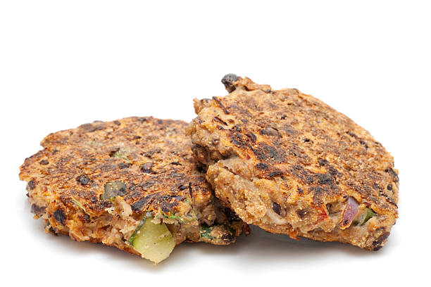 two cooked vegetarian black bean hamburger patties stock photo