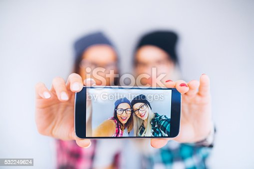 Two cool friend taking selfie