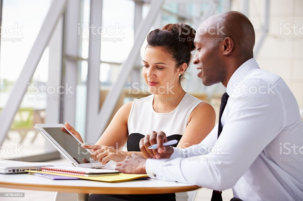Two corporate business colleagues working together in office stock photo