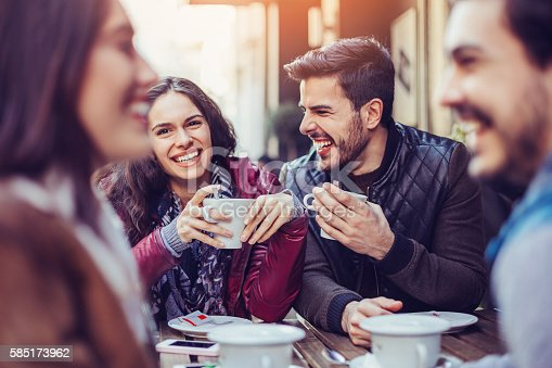 istock Two couples drinking tea and coffee 585173962