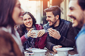Two couples drinking tea and coffee