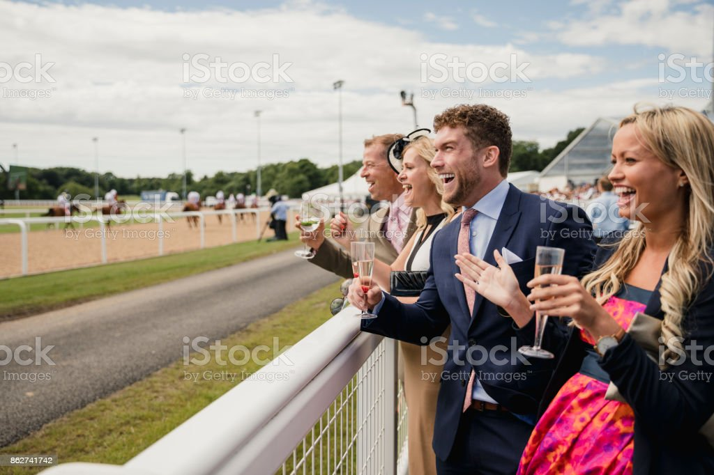Two Couples Enjoying a Drink stock photo