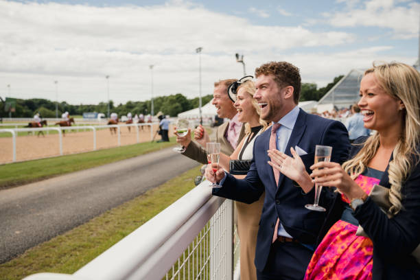 Two Couples Enjoying a Drink Couples enjoying a day at the races. Two couples enjoying a drink at the races. upper class stock pictures, royalty-free photos & images