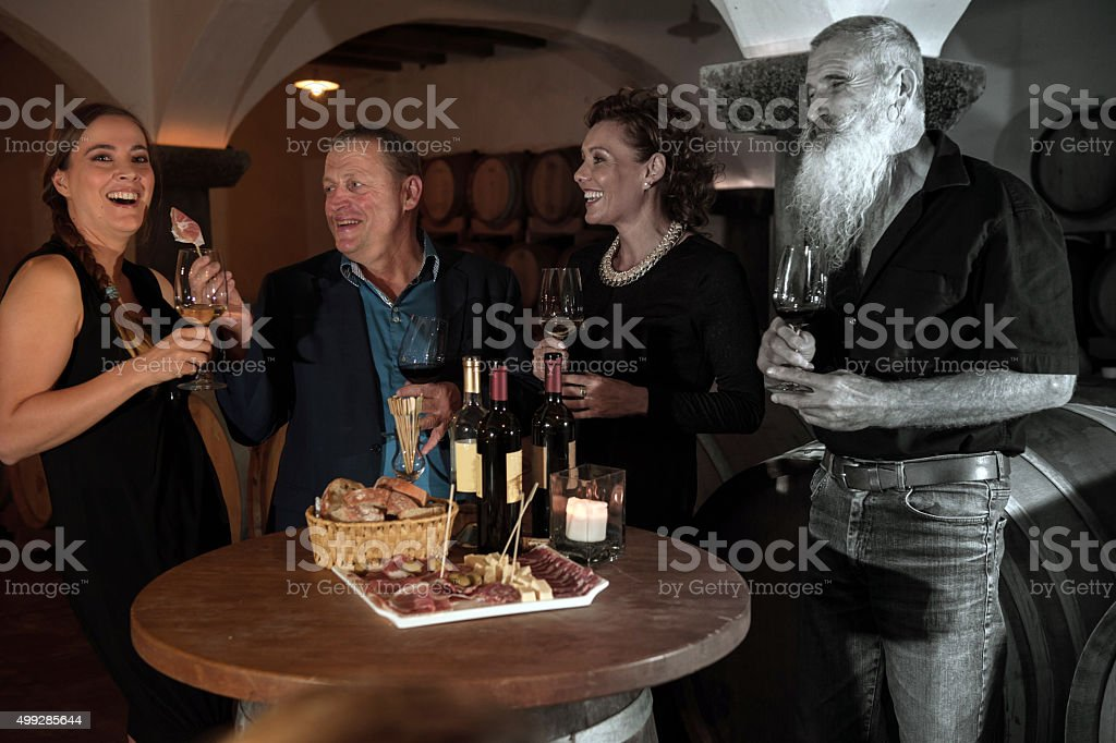 Two Couples Enjoying Food and Red Wine, Color and B&W stock photo