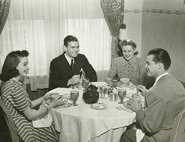 two couples having dinner, (b&w) - 1940s style stock photos and pictures