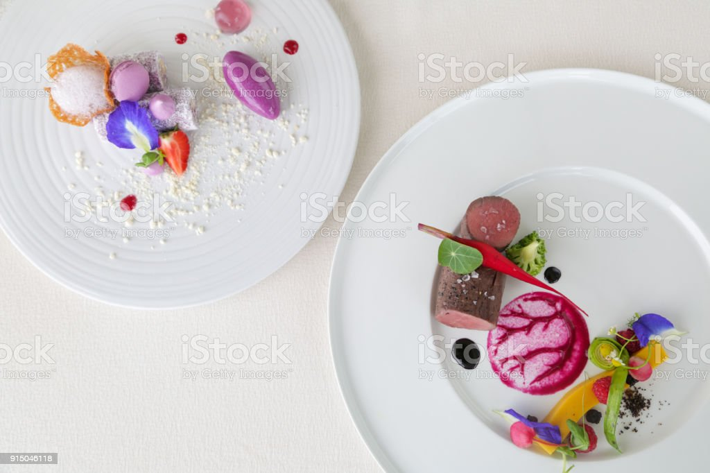 Two courses of elegant, creative restaurant meal - haute couture food concept stock photo