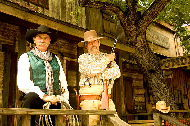 two cowboys - western town stock photos and pictures