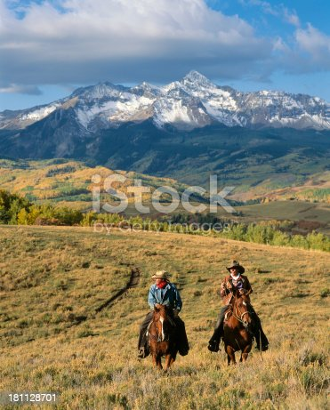 Wranglers riding their horses in fall with scenic snow dusted mountains in the backgroundMore of my Cowboy images