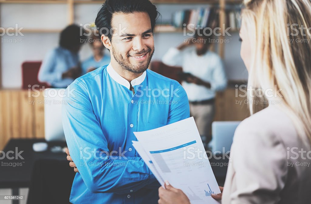 Two coworkers making a great business discussion in modern office stock photo