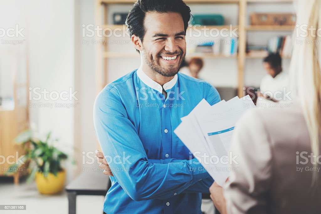 Two coworkers making a great business project discussion in modern stock photo