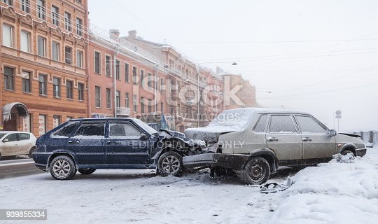 Saint-Petersburg, Russia - February 22, 2018: Two crashed Russian cars in accident on winter street with snow