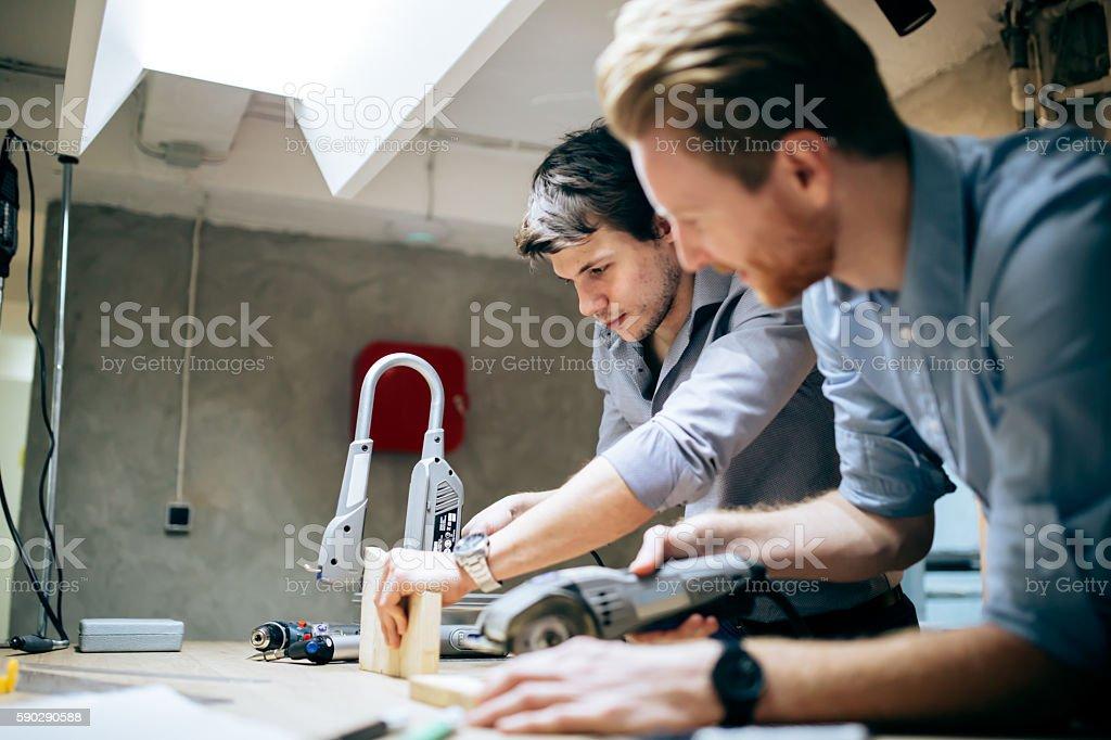 Two creative designers working in workshop royaltyfri bildbanksbilder
