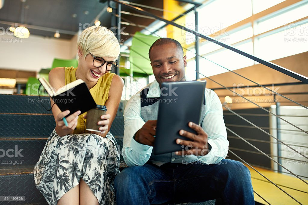 Two creative millenial small business owners working on social media royalty-free stock photo