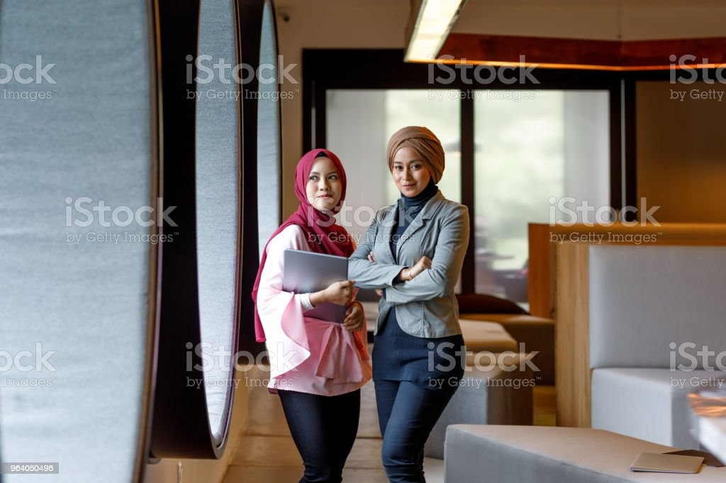 Two Creative Muslim Women Discussing Ideas - Royalty-free Adult Stock Photo