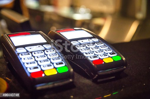 istock Two credit card reader above restaurant counter 496440748