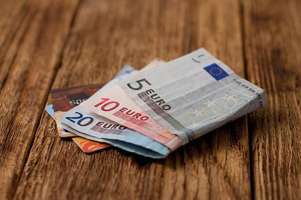 Two credit cards placed in euro bills stock photo