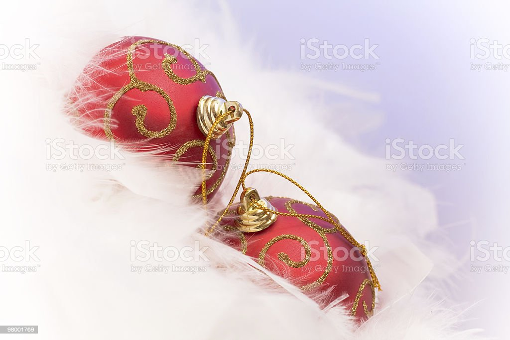 Two cristmas baubles lying on feathers royalty-free stock photo